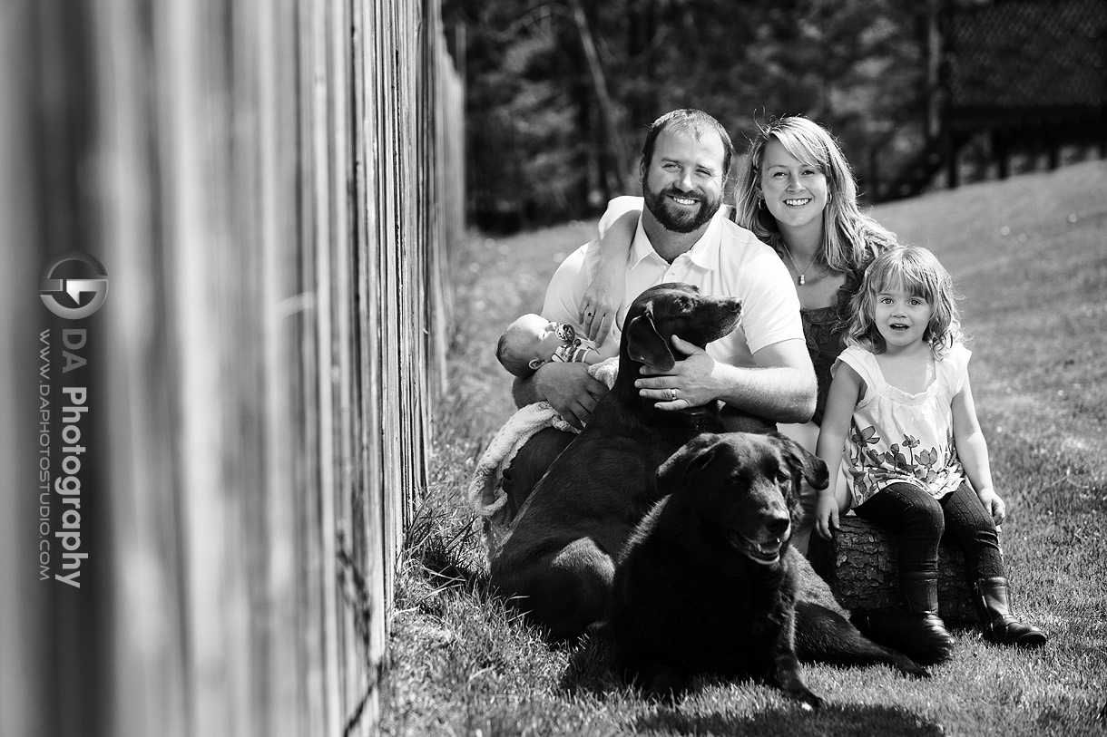 Family portrait by the fence - Family Photo Session by DA Photography, www.daphotostudio.com, Sutton, ON