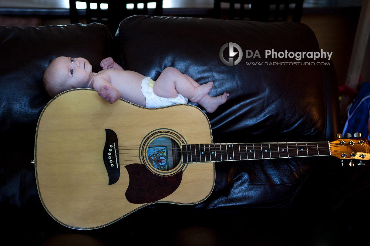 Newborn baby on a guitar - Family Photo Session by DA Photography, www.daphotostudio.com, Sutton, ON