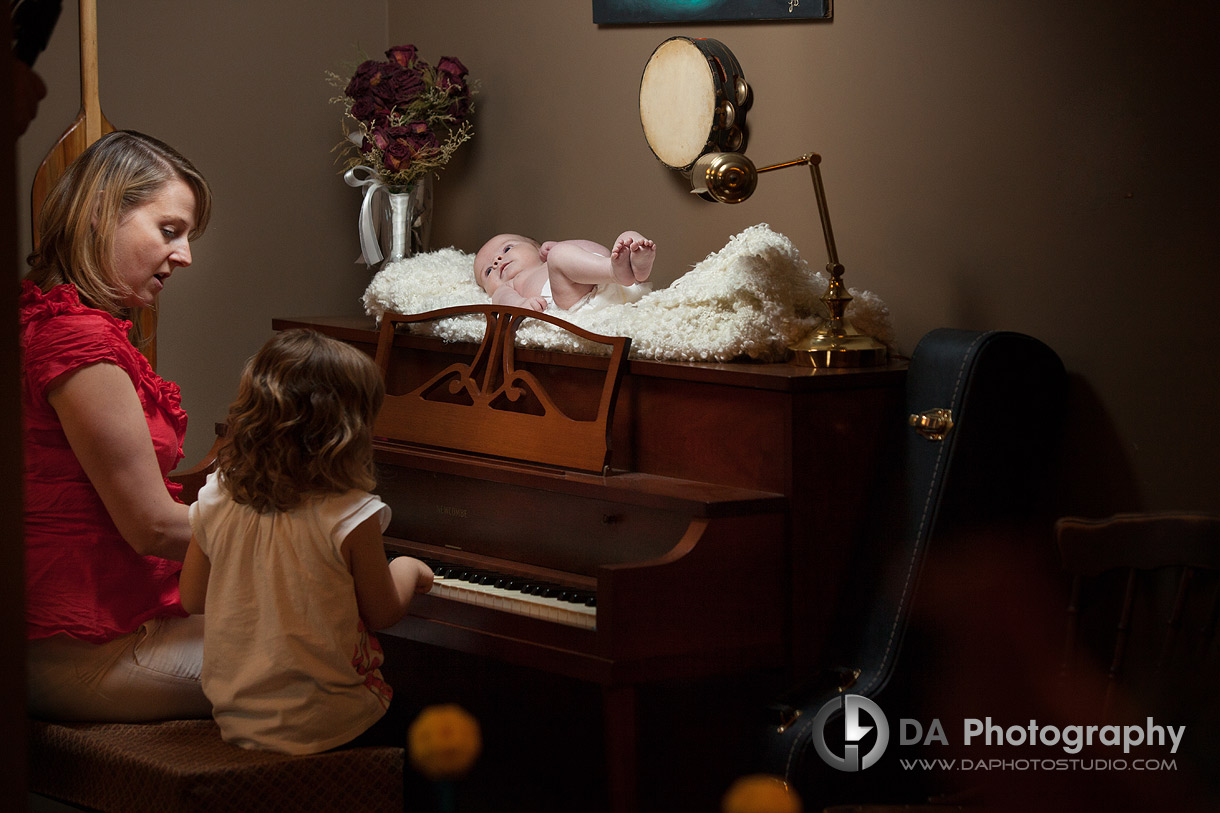 Mommy with her two little ones play on a piano - Family Photo Session by DA Photography, www.daphotostudio.com, Sutton, ON